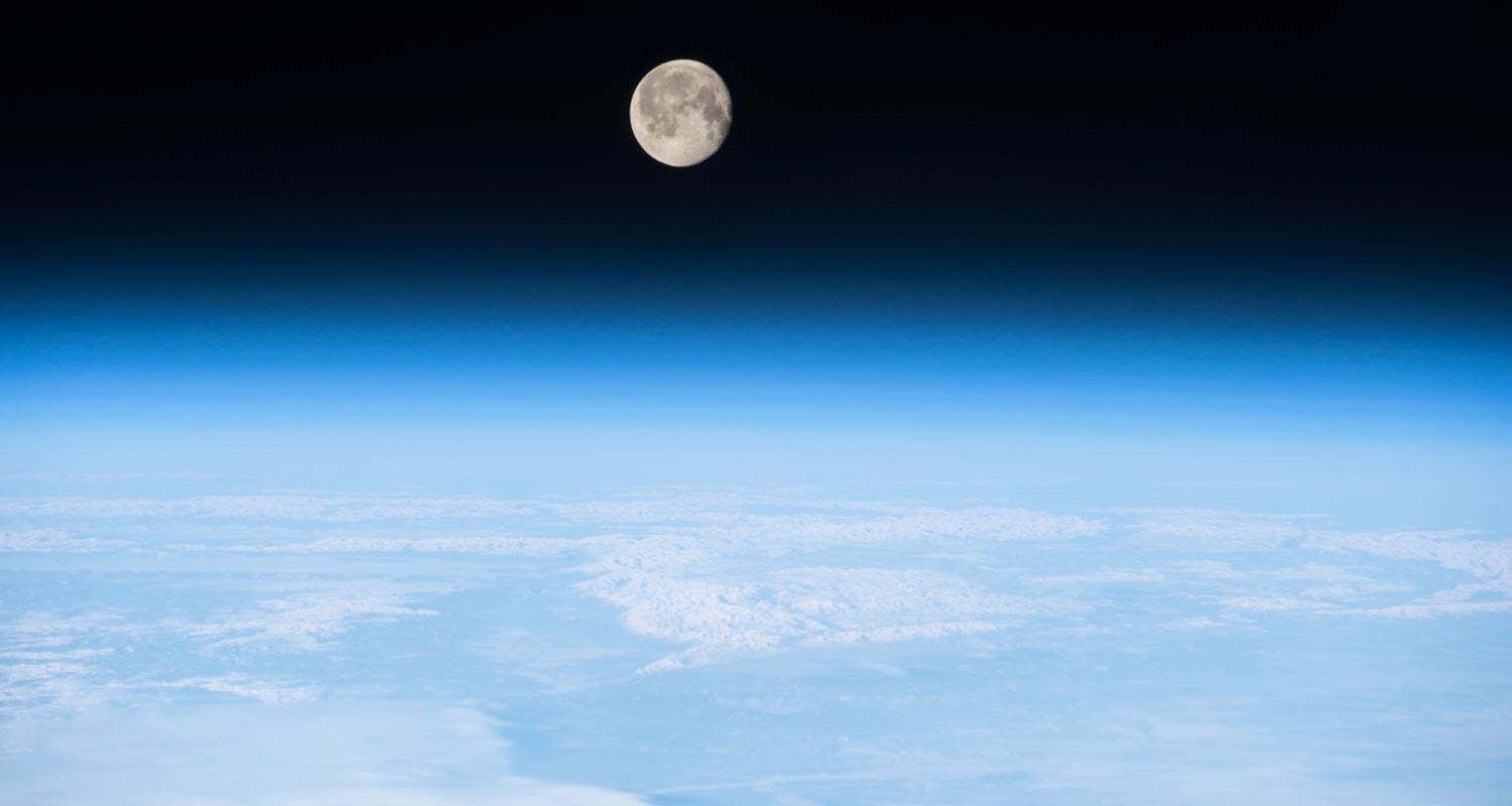 Moon over Earth's atmosphere