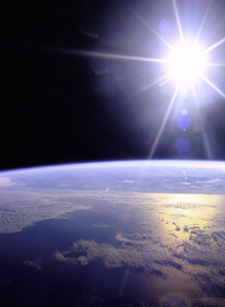 the sun shining with earth at the horizon
