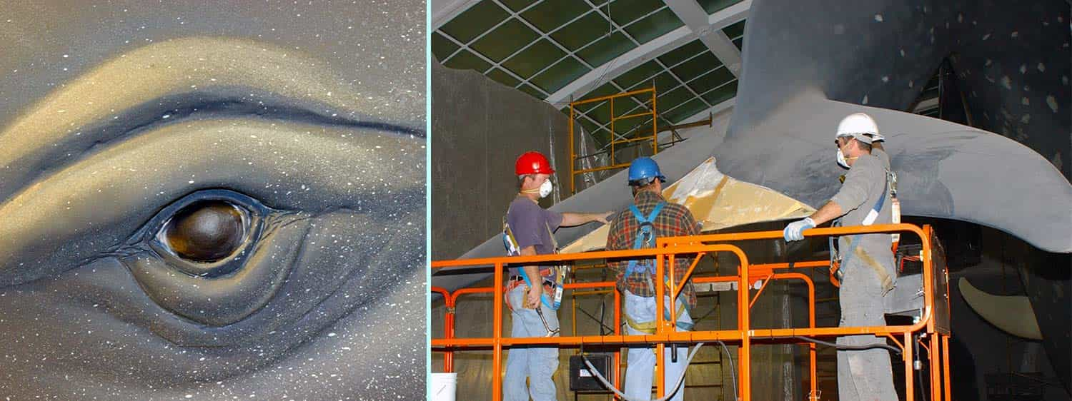 2 images: Closeup of whale model's eye; Construction workers gathered around whale model's tail