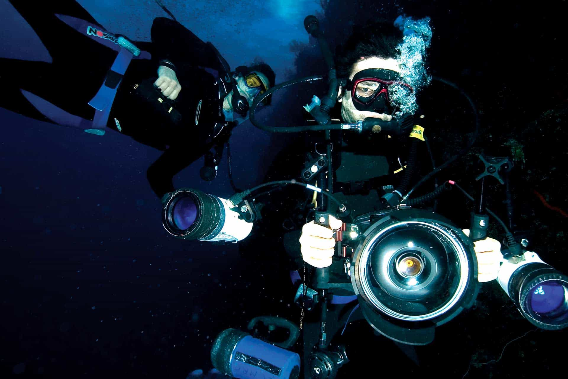 two scientists with underwater camera