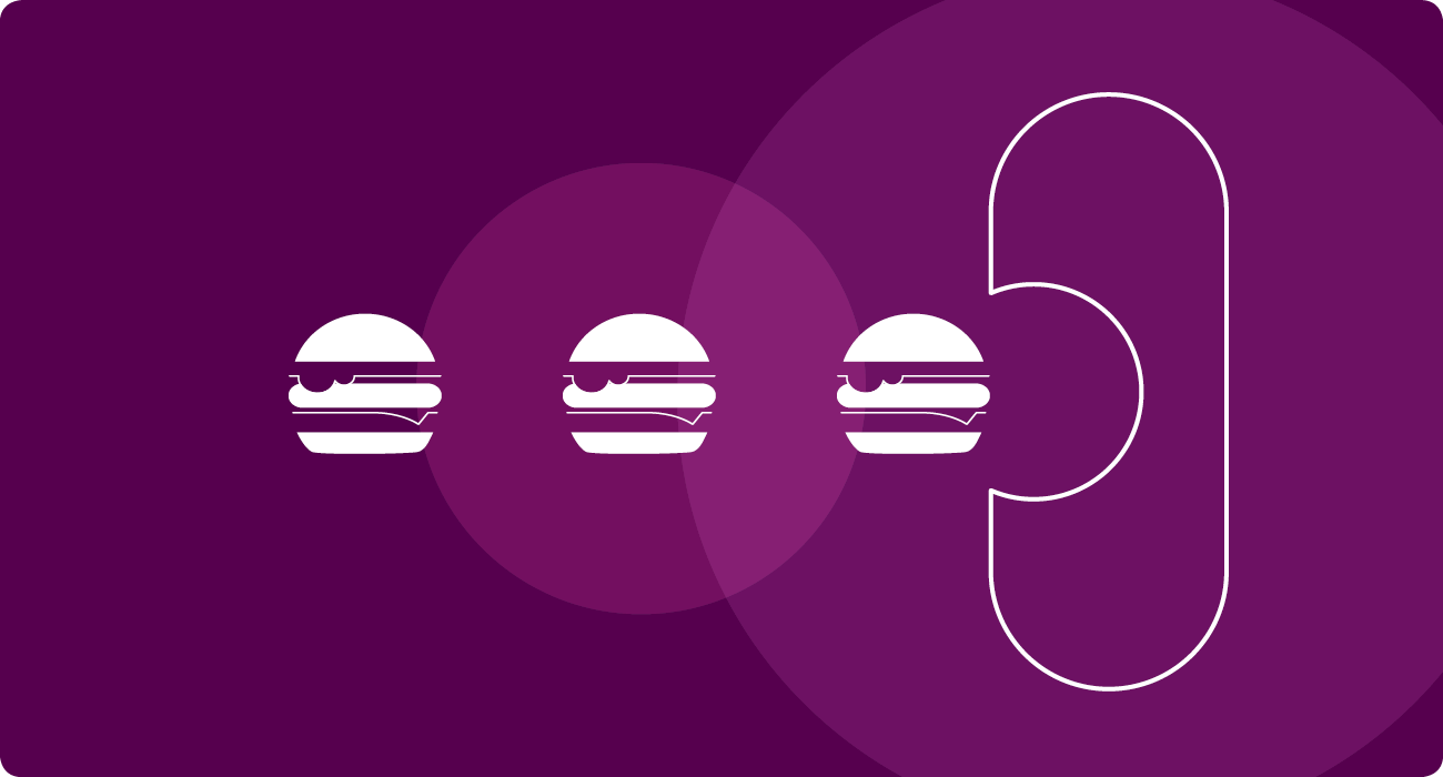 Icon of a bacteria eating burgers.