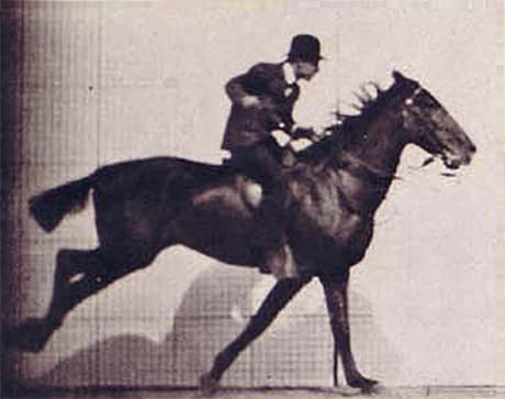 side view of man riding a galloping horse