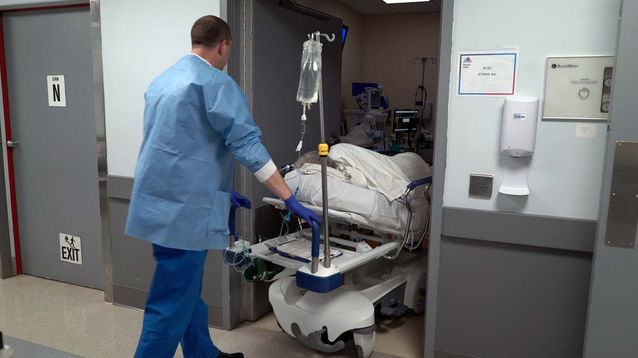 The patient is wheeled into the endoscopy suite where he will be sedated for the procedure.