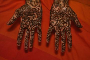 Two hands with henna body art.