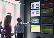 Scientists at INGV observe the wall of digital monitors that constantly relay Etna's vital signs. AMNH