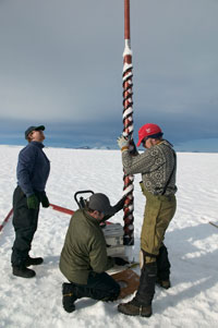Scientist Jason Box from Byrd Polar Research Centre, Ohio State University, drills a long hole in the ice to extract ice core samples. Nick Cobbing/Peter Arnold