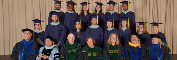 Graduation photo of Cohort Three students and senior faculty from the Masters of Arts in Teaching Program