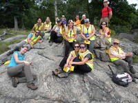 Students in the MAT program wearing safety gear pose for a picture during the Science Practicum field camp.]