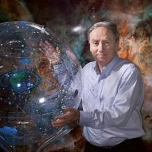 Mario Livio holding a translucent globe mapping the constellations