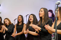 Members of the Sweet Out-of-Lines female vocal ensemble of the Celia Cruz Bronx High School of Music performing