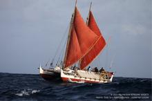 The ship Hōkūleʻa sailing at sea.