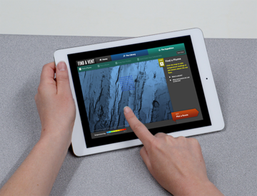 "a person using the ""Find a Vent"" interactive on an iPad"