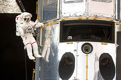 Astronaut John Grunsfeld performs work on the Hubble Space Telescope. © NASA 2009