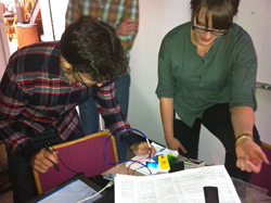David Gruber and Amy Vlastelica use a spectrophotometer to measure the spectrum of emitted light. Photo courtesy of John Sparks