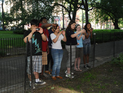In the Museum's Urban Biodiversity Network program, students document urban biodiversity using mobile devices. © AMNH/C. Chesek.