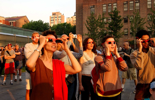 At sunrise on June 8, 2004, people gathered on the Arthur Ross Terrace at the Museum to watch the last transit of Venus. Eclipse-viewing glasses are recommended to protect eyes from dangerous solar rays. © AMNH/D. Finnin