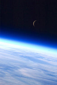 Earth and Crescent Moon from ISS