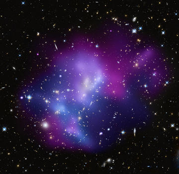 This composite image shows the massive galaxy cluster MACSJ0717.5+3745, where four separate galaxy clusters have been involved in a collision, the first time such a phenomenon has been documented. Hot gas is shown in an image from NASA's Chandra X-ray Observatory and galaxies are shown in an optical image from NASA's Hubble Space Telescope. Credit: X-ray (NASA/CXC/IfA/C. Ma et al.); Optical (NASA/STScI/IfA/C. Ma et al.)