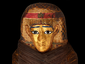 Mummy coffin displays cartonnage, a papier-mâché like substance made from glued layers of papyrus or linen, then covered with gilding.