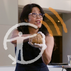 Dr. Wendy Suzuki holds a preserved human brain before an audience while giving a lecture, with the museum's podcast logo overlaid on top