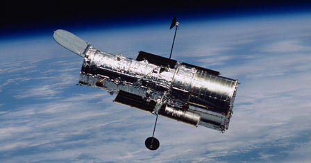 The Hubble telescope soars through space