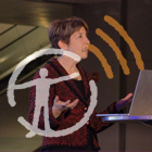 Marlene Zuk speaks to the SciCafe audience, with the AMNH podcast logo overlaid on top.
