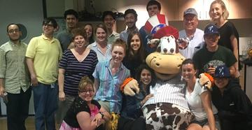 Staten Island Yankees mascot with graduate students and staff
