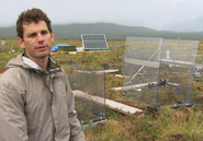 Ecologist Ted Schuur at the Eight Mile Lake research site, where experimental enclosures measure the exchange of carbon between melting permafrost, air, and vegetation.AMNH