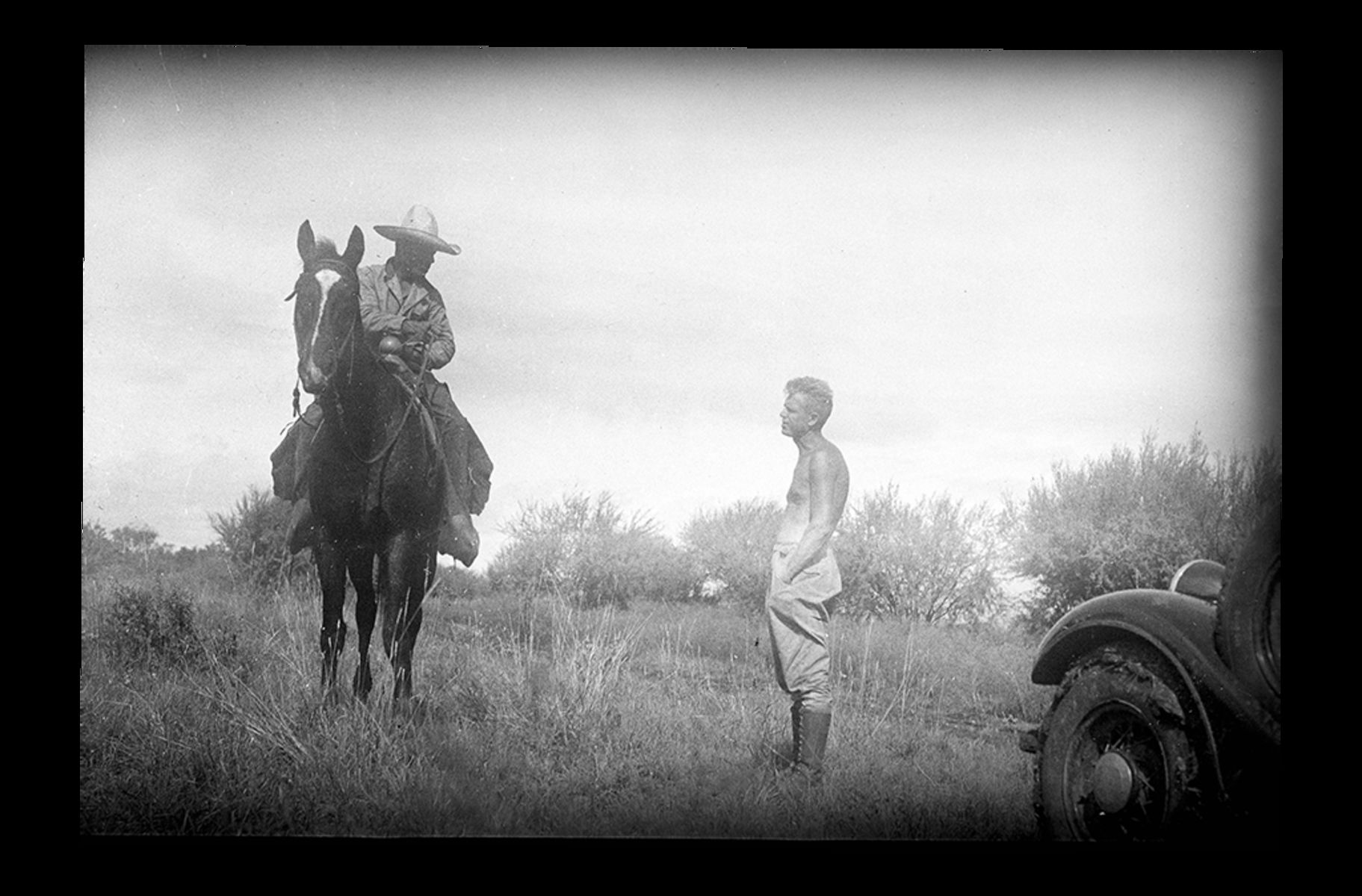 Alfred Kinsey talks with a man in a sombrero on horseback during a field trip to collect gall wasp specimens in North America.