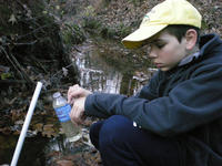 alexander-obtaining-a-water-sample