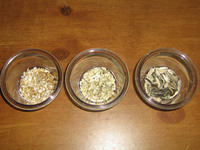Three glass dishes containing, respectively, oat groats, safflower seeds, and sunflower seeds