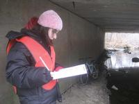 Annie, 13, a 2008 Young Naturalist Awards essay winner, standing under a bridge, taking notes