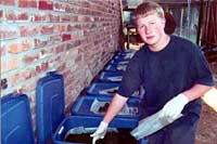Eric with several vermicompost bins