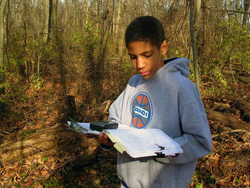 Using GPS unit to record location of toad found at Gallant Preserve.