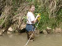 Shannon taking river measurements