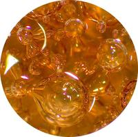 Brown silicate glass containing small to large spherical and elliptical gas bubbles.