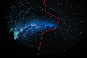 This image of the Milky Way over New York City is shown using the new projection system on one side (left of the red line) and the previous system on the other side (right of the red line).  Image: © AMNH/D. Finnin.