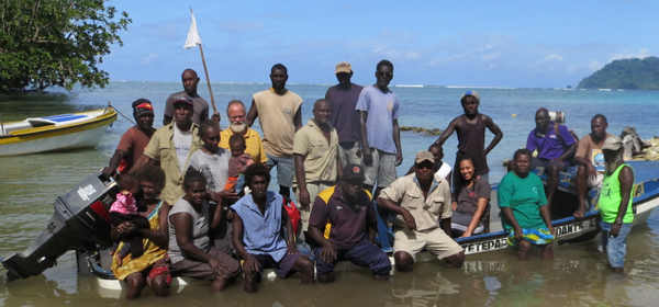 Tetepare rangers gathering on a beach