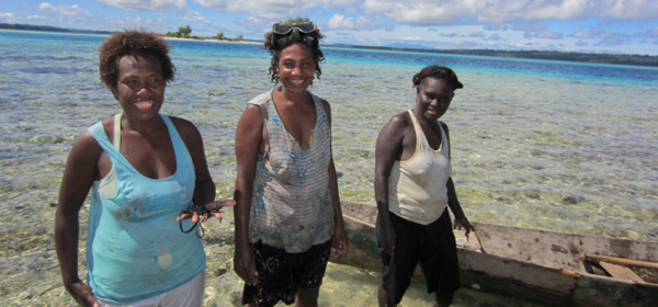 Women gathering shellfish in the Solomon Islands